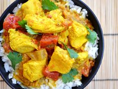 Turmeric chicken: olive oil, onion, ginger, garlic, turmeric, cumin, cinnamon, red pepper, bay leaf, chicken, tomatoes, coconut milk, salt, pepper, cilantro, rice