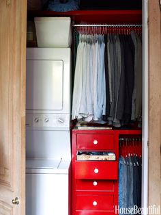 One side of this closet houses a compact washer and dryer set.