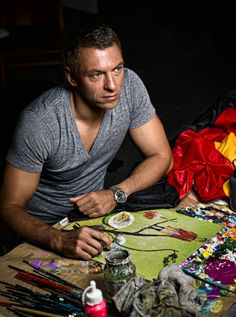 Artist Olaf Hajek working at his studio.