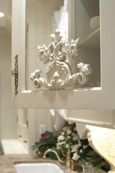 wood applique on a glass front cabinet door