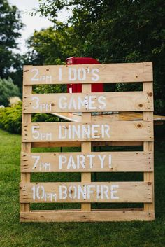 Wooden Pallet Order of The Day Sign | Outdoor Humanist Ceremony | Festival Wedding | Rustic Tipi Reception | Talton Lodge | Bouncy Castle | John Hope Photography