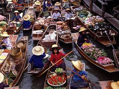 Floating Markets. Love the visual imagery of the boats full of items to sell!