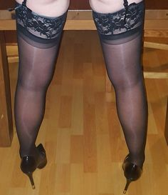 Top lace black stockings with glossy black heels.