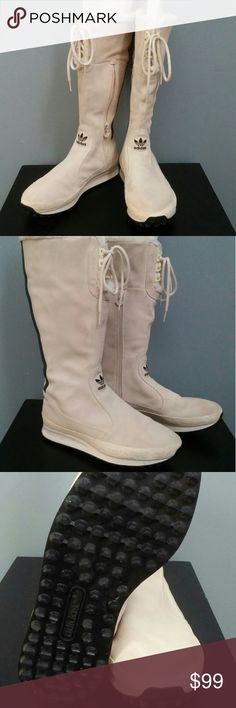 Adidas Women's White Suede Boot Adidas White Suede Sneaker Boot new used in a video and never worn. There is damage on the left heel but I think it can be repaired. I am discounting $50.00 to cover repair. For the real Adidas lover in you. Ladies size 9. Adidas Shoes Athletic Shoes