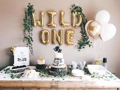 """WILD ONE letter balloons - Balloon bouquet of 3 gold & 3 white - White Straw – 8 inch. Wild One party decorations. Wild One birthday. Wild one decor. First birthday party ideas. First birthday boys. 1 Year Old Birthday Party, Boys First Birthday Party Ideas, Baby Boy First Birthday, Boy Birthday Parties, 1st Birthday Party Ideas For Boys, 1st Birthday Themes Girl, 1st Birthday Favors, Twin Birthday, Dinosaur Birthday"