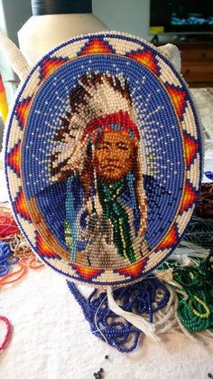 The last project I finished was a necklace made of size 13 white cut beads. It's a Chief Washakie necklace that was ordered by his great, great grand daughter. Thank you for the order! And thank you Corner Mercantile for featuring my art! Indian Beadwork, Native Beadwork, Native American Beadwork, Native American Patterns, Native American Art, Beading Projects, Beading Tutorials, Bead Loom Patterns, Beading Patterns
