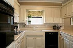 Kitchen remodel for under $100. And it's gorgeous! Lots of awesome renovating ideas on her site