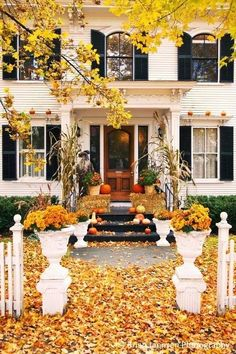 New England in the Fall Front porch in autumn, Woodstock, Vermont, USA.