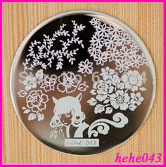 Hehe 043 (http://www.aliexpress.com/store/product/Free-Shipping-Stamping-Nail-Art-8pcs-lot-hehe043-Stamping-Image-Plate-hehe/613434_32249521839.html)