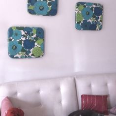 Something Old: outdoor patio seat cushions found at a thrift shop ($10 each) =  Something New: cute, mod, living room wall art