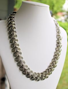 Handmade sterling silver Egyptian coil necklace by Susan Pauls. Made with over 30 feet of 16g sterling silver wire. Available at Northland Exposure Artists' Gallery, Parkville, MO.