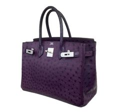 This exquisite purple raisin colored Hermes Birkin was spotted on Victoria Beckham making it an extremely sought-after bag. With its ostrich skin and palladium hardware, this Birkin by Hermes is truly a masterpiece. As a valuable collector's item, it's nearly impossible to find anywhere else.