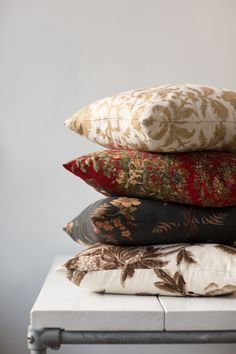 Reds, golds, blacks, and greens - not as bizarre of a combination as you might think! These cushions are DIY-able and you can find all these fantastic fabrics in floral and toile at http://www.marthas.co.nz/