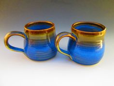Vibrant blue and brown rustic coffee cup pair!  Made with cobalt, rutile iron and the power of the sun!  Soquel Pottery, CA