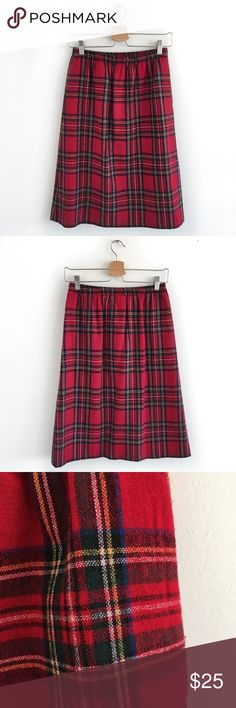 "HP Vintage Red Buffalo Plaid Midi Skirt Small SUPER CUTE Vintage Red Buffalo Plaid Midi Skirt. Size Small. Excellent Vintage Condition. No visible flaws. The tag lists ""6P"", but it measures like a modern Small (refer to measurements). Pull-on style. Stretchable waist band. Pockets! Fully lined. 48% Viscose, 47% Wool, 5% Other Fibers. Lining: 100% Polyester. Dry Clean Only. Waist: 13"" (stretches). Hips: 20"". Length: 25"".  If you love vintage (like me!), check out my closet @mogibeth…"