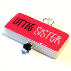 Little Sister Domino Pendant by littlebugsboutique, via Flickr Sister Crafts, Little Sisters, Cufflinks, Pendant, Accessories, Hang Tags, Pendants, Wedding Cufflinks, Jewelry Accessories