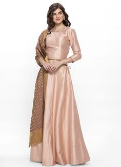 Beige dupion bias cut lehenga with side zip and drawstrings is fully lined and paired with a matchi. Clothing Websites, Dress Cuts, Bridesmaid Dresses, Wedding Dresses, How To Look Classy, Lehenga, Beige, Crop Tops
