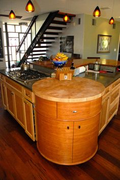 A circular cherrywood drum with a butcher block top. The rest of the cabinets are maple frames with bird's eye maple insets.