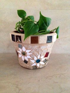 A personal favorite from my Etsy shop https://www.etsy.com/listing/233479794/handmade-mosaic-flower-pot-outdoor