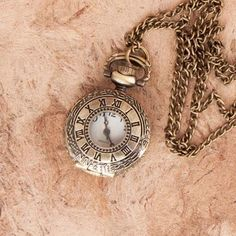 Open Face Locket #PocketWatch : The locket has an #antiquebrass finish with a circular opening on its flip-open lid, allowing you to still see the time