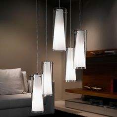 The Pinto Five Drop Pendant Lamp has Transparent and Opal Glass Shades with Chrome Metalwork. Eglo 93003