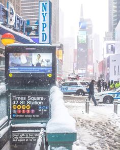 Times Square in a snowy day by Kelly Kopp @kellyrkopp by newyorkcityfeelings.com - The Best Photos and Videos of New York City including the Statue of Liberty Brooklyn Bridge Central Park Empire State Building Chrysler Building and other popular New York places and attractions.