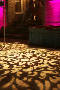 textured lighting on floor. Uplighting in background
