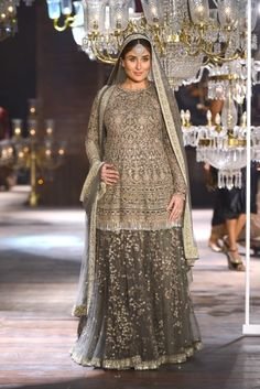 She is living her best life in that intricately embroidered outfit. | Here Are 10 Photos Of Kareena Kapoor Khan Walking The Ramp At LFW In All Her Pregnant Glory