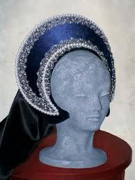French style hood which Anne Boleyn preferred. She wore this style so that more of her dark hair would show through.