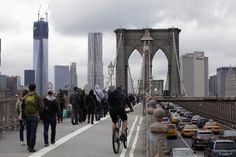 Brooklyn Bridge, N.Y.  Commuters cross New York's Brooklyn Bridge, Wednesday, Oct. 31, 2012. The floodwaters that poured into New York's deepest subway tunnels may pose the biggest obstacle to the city's recovery from the worst natural disaster in the transit system's 108-year history.