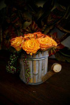 By me... love orange roses!