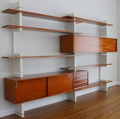 Anonymous; Teak and Lacquered Wood 'Extenso' Shelving Unit by Amma, 1961.