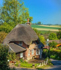 A pretty thatched cottage above the village of Pitton in Wiltshire, England. Fairytale Cottage, Storybook Cottage, Garden Cottage, Cottage Homes, English Country Cottages, English Village, English Countryside, Little Cottages, Cabins And Cottages