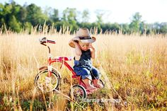 Yeehaw! Cute cowboy on a tricycle! Photo Session Ideas | Props | Prop | Child Photography | Clothing Inspiration| Fashion | Pose Idea | Poses | Tricycles