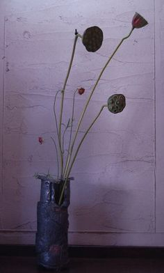 rustic japanese vase. love the composition with the pods