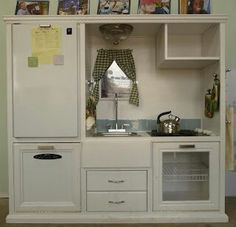 Old entertainment center repurposed into a childs play kitchen