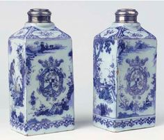 A PAIR OF DUTCH DELFT BLUE AND WHITE CHINOISERIE ARMORIAL GIN BOTTLES AND SILVER COVERS MARKED AK FOR ADRIANUS KOCKS AT DE GRIEKSCHE A, 1686-1695, THE SILVER MOUNTS AND COVERS GERMANY, LATE 19TH CENTURY