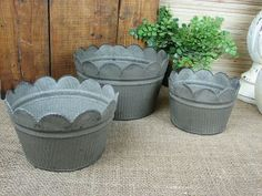 This set of buckets will come in handy around the house. They feature a scalloped edge and a raised floral design. Use them for flower pots or use them for storage in the kitchen or laundry room.Measurements:Large: 4.5