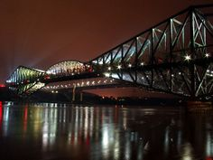 The Quebec Bridge (Pont de Québec in French) crosses the lower Saint Lawrence River to the west of Quebec City, and Lévis, Quebec, Canada. Pays Francophone, Saint Lawrence River, Trois Rivieres, Discover Canada, Belle Villa, Night Photos, Quebec City, Night Photography, Photography Tips