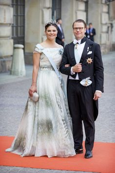 The sister of the groom, Crown Princess Victoria with her husband Prince Daniel, wearing a costume creation from H&M Conscious Collection.