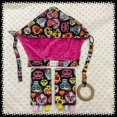 A personal favorite from my Etsy shop https://www.etsy.com/listing/460156434/sugar-skulls-tulahoodsreach-strapsbaby