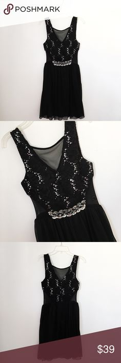 NWOT beautiful black prom/homecoming dress In perfect condition, sparkle Embellishments all over dress. Open sheer  sides and top. Must go! Free gift included 🎁 BCX Dresses Prom