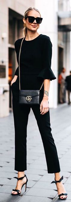 woman wearing black trumpet-sleeved top and pants. Pic by @fashion_jackson