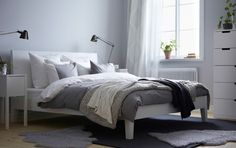 NORDLI bed with bedside table and SVEIO chest of drawers all in white