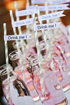 Straws, straws straws! Paper swirled straws cute for parties for a little fun in the drinks. The 'drink me' signs are also a cute touch in the milk bottle like bottles. Love this whole concept.
