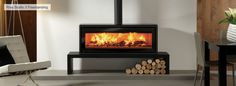 Stovax – Riva Studio Freestanding. the Freestanding version may be mounted on a hearth or installed onto a Riva Bench. Styling options include a black glass top plate, gloss black enamel flue pipe and square section flue covers, click for full details.