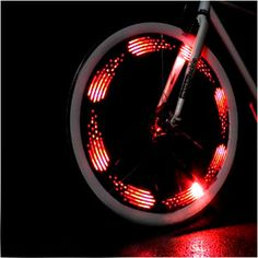Unique and fun gift idea! The MonkeyLectric Monkey Light bike wheel light attaches to spokes and displays simple, colorful graphics on the spinning bike wheel to light up the night with a highly visible display. Fixed Gear Bikes, Bicycle Spokes, Bicycle Wheel, Bicycle Lights, Bike Light, Spin Bikes, Buy Bike, Road Bike Women, Mercedes Benz Logo