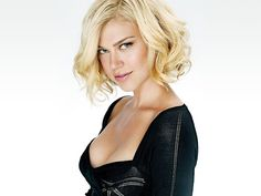 Adrianne Palicki cleavage in a low cut black dress