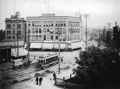 Hastings at Cambie showing streetcar, Woodward's cart, and corner of the Court House garden, circa 1905 (Photo by Philip T. Timms via Vancouver Archives)