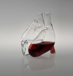 Heart (Cuore) decanter by Paola C. Produced by Paola C, this unusual decanter comprises two glass carafes shaping a human heart when joined together intended to hold both water and wine. It is made from transparent blown pyrex and can hold 1 1/2 litres of both wine and water. Each carafe is hand blown by artist Tommaso Colesanti, and produced on request (in other words, you can't afford it if you have to ask). #wine
